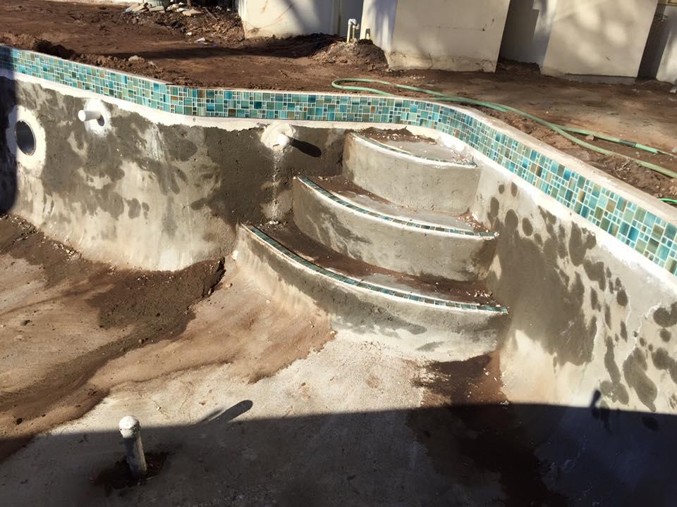Installing decorative tiles for custom pool in St Augustine