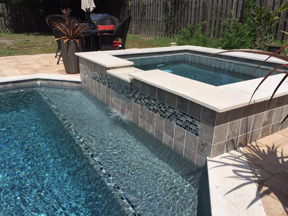 Raised spa with waterfall