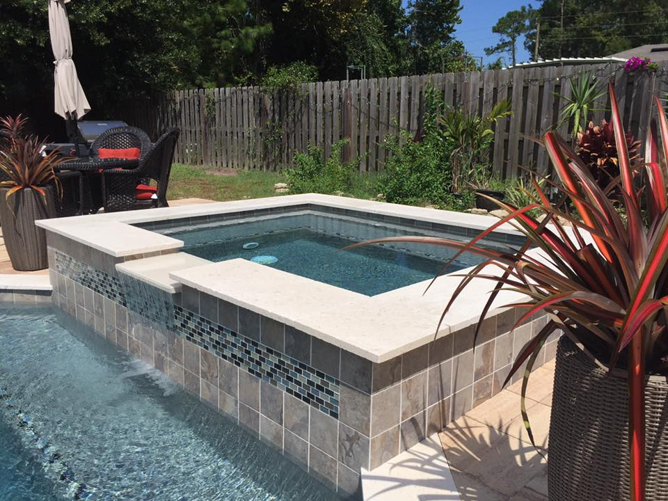 Raised spa with travertine coping