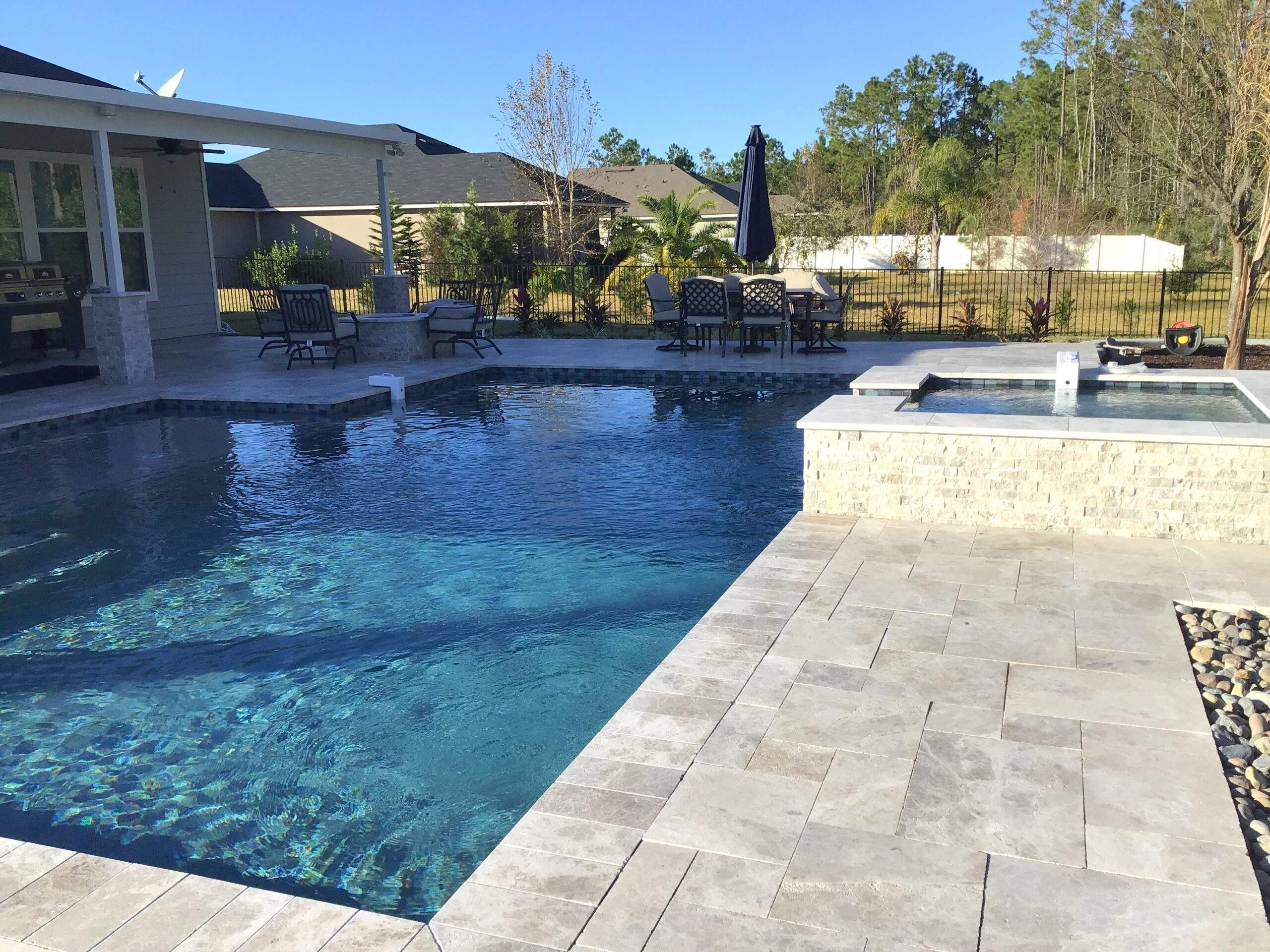 Custom pool and spa with fire pit in St Augustine