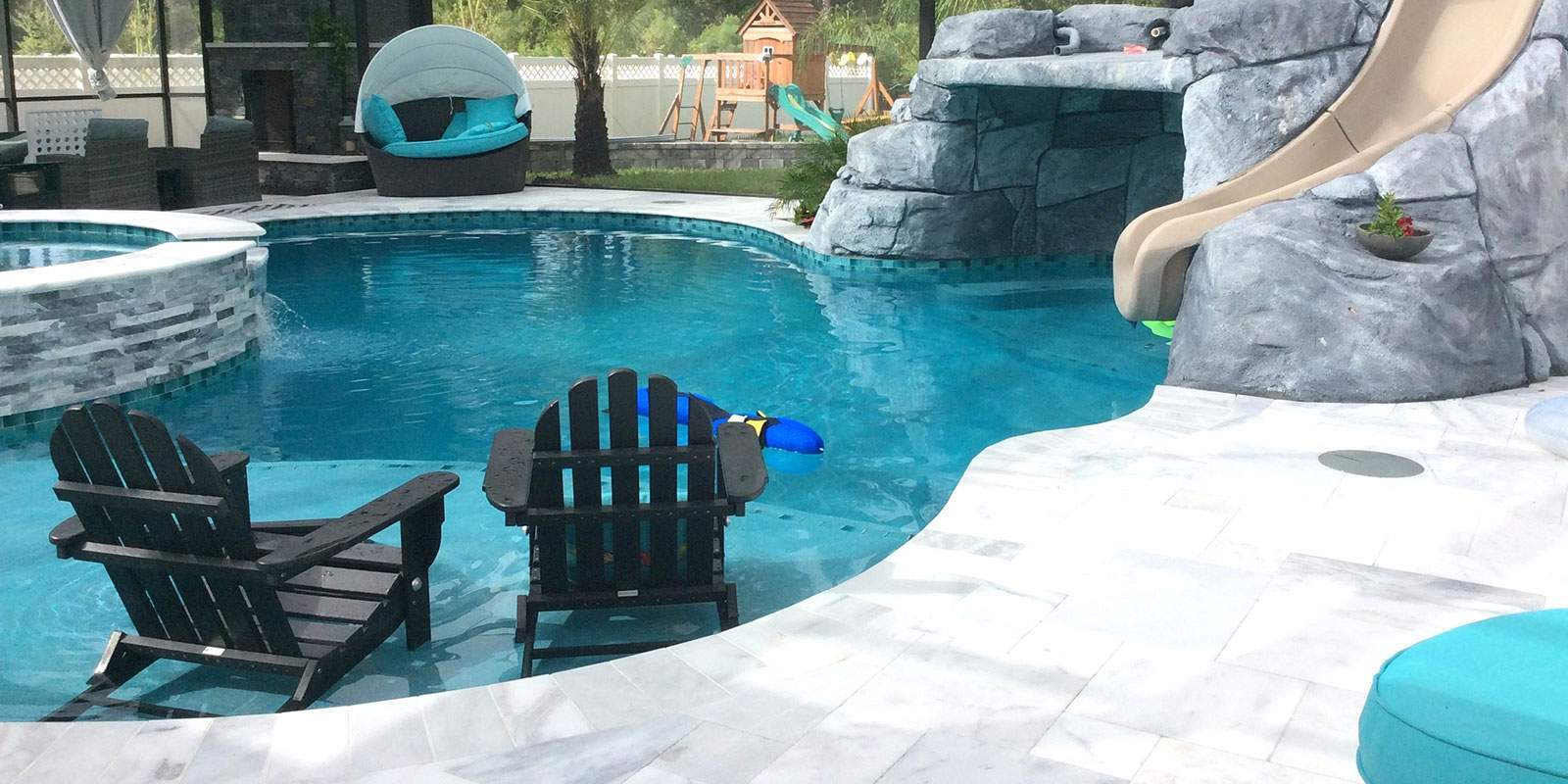 Custom pool and spa construction with grotto and slide
